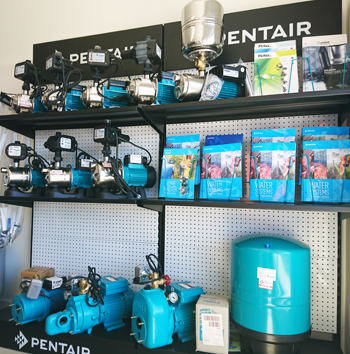 Shop floor with Pentair product display.