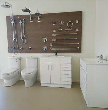 Shop floor showing toilets, sinks, taps, showers and rails.